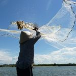 Local cast fishing net in Hoi An river, Vietnam Tours