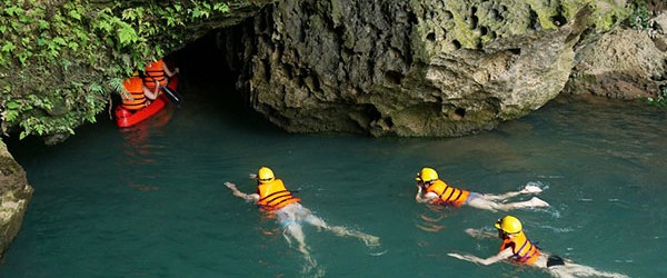 Swim and kayak to get inside Dark cave